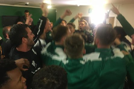 City's players and staff celebrate their rather straightforward progress to round two