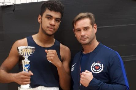 Horsham Boxing Clubs Madhav Purcell with coach Danny Essex. All pictures courtesy of Libby Baker