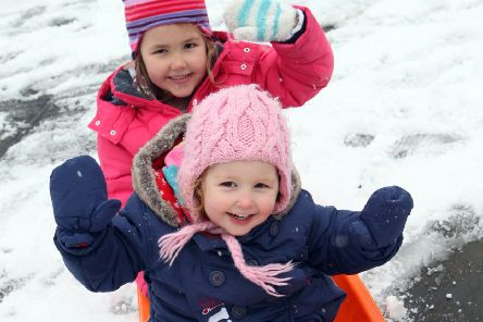 Izabella, five, and Matilda Whitmore, two, in Horsham Park. Photo by Steve Cobb.