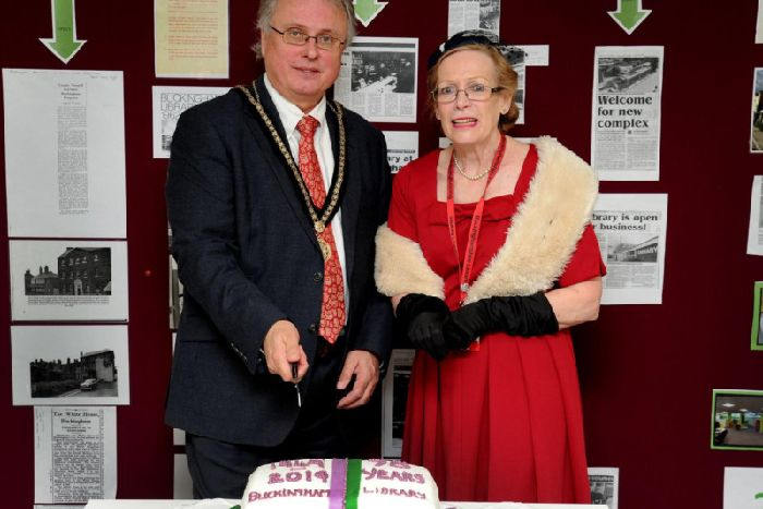 Buckingham councillor Jon Harvey along with library staff member Pam Scowen at the cake cutting