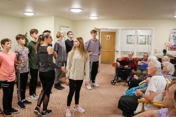 Sleeping Beauty cast bring Christmas cheer to Chichester care home