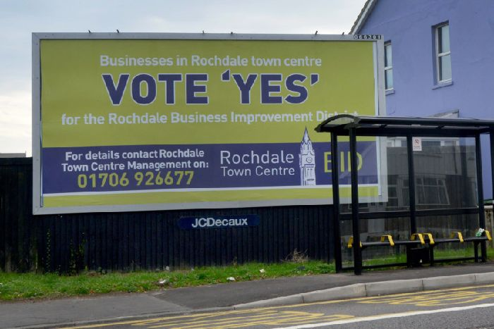 523de785f A billboard poster calling on businesses in Rochdale to vote for a business  improvement district has
