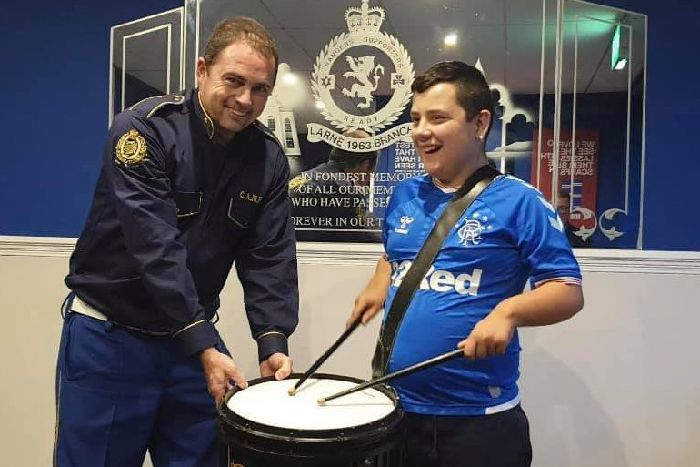 East Antrim flute band donates drum to Hill Croft pupil