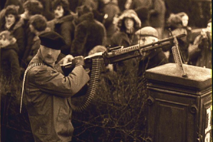An IRA gunman with an M60 machine gun on the streets of the Bogside at a Bloody Sunday commemoration in January 1978
