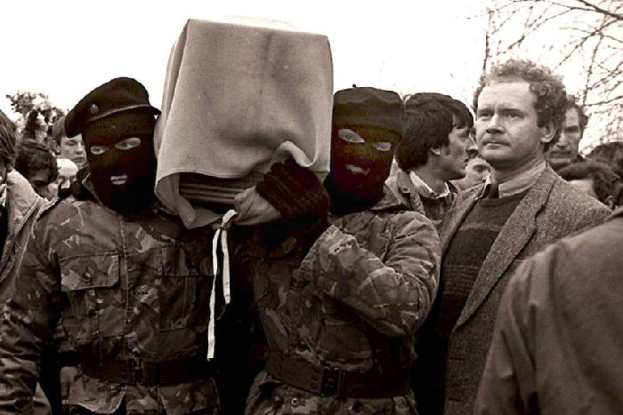 Sinn Fein vice-president Martin McGuinness pictured with masked IRA men at the funeral of Brendan Burns, 1988