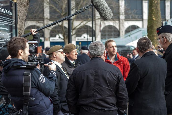 Director Aaron Sayers (pictured in the red) with veterans from the UK Veterans One Voice March in Whitehall during the filming of Chosen Men.