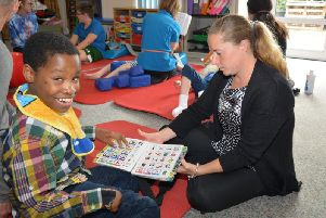 Speech and Language Therapist Amy Bennett with one of the children