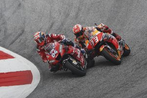 Andrea Dovizioso passes Marc Marquez to snatch victory at the final corner.