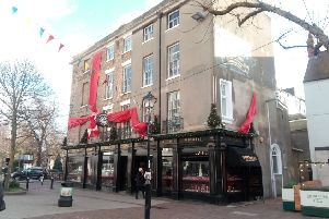 High winds have sadly damaged the treasured red ribbon at Whibleys the Jewellers in Worthing