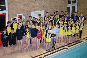 Linslade Crusaders swimmers with their county medals and trophies