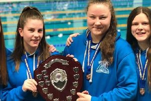 Members from Dunstable SC's double gold relay team