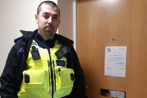 An officer outside one of the closed brothels