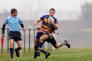 Wing James Wales hits fast forward for Gosport & Fareham against Farnham. Picture: Chris Moorhouse