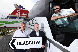DRIVING GROWTH: Aodh Hannon (left) of Hannon Coach has revealed plans to expand the companys direct luxury coach service between Belfast and Glasgow to other towns across Northern Ireland. The County Armagh-based coach operator launched its Glasgow Express to and from Belfast in February this year and, following a highly successful first six months, has now submitted applications to introduce further direct services between the popular Scottish city and many of Northern Irelands main towns, including Enniskillen, Coleraine, Ballymena, Derry~Londonderry, Cookstown, Strabane and Newcastle. Stena Lines Ian Baillie (centre) reported that the ferry company has experienced a 7.5% increase in coach traffic to Glasgow since Hannon Coach launched the Glasgow Express service which operates twice daily in both directions and is the only direct city to city through-coach service (i.e. using the same coach for the entire journey) from Northern Ireland. Also in the picture is driver Jim McAlorum.