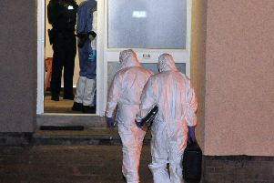 Police and forensic investigators in the Devenagh Court area of Ballymena where the man was found dead