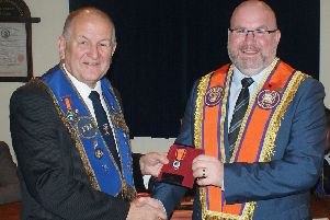 Bro. Morris Cairns from Diamond LOL 1422 receives his 50 year Service Jewel from Bro. Stephen Foster of LOL 591.'The special presentation was made in the presence of a large gathering of Diamond LOL 1422 members in the Diamond Memorial Orange Hall, Muckamore.'Bro. Morris Cairns was initiated into Fawny Fort LOL 2048 City of Londonderry Grand Lodge Number Five in May 1966 and transferred into the Diamond LOL 1422 Antrim District No. 13 in 1973.