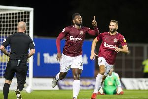 Aaron Pierre celebrates his first goal of the season at Oxford United