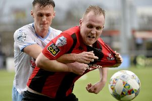 Crusaders Jordan Owens in action with Ballymena's Scott Whiteside
