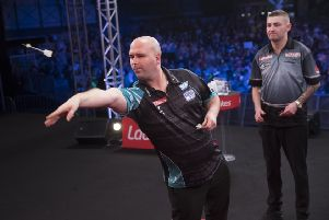 Rob Cross at the oche during the final of the Ladbrokes UK Open against Nathan Aspinall. Picture courtesy Lawrence Lustig/PDC