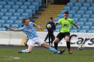 Ballymena United's Jonathan Addis tackles a Warrenpoint player
