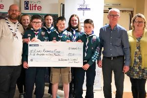 Members of the  Fifth Ballymena Scout Group travelled to the City Hospital to present the �508 they raised in a Charity Bag Pack in Tescos for The Northern Ireland Kidney Research Fund.
