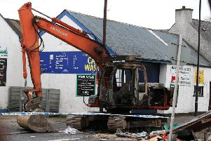 A digger burned out after an ATM theft