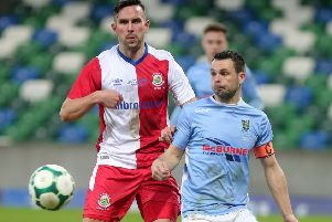Linfield's Andrew Waterworth (left) with Ballymena's Jim Ervin