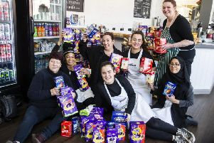 Jeanette Walsh, left and the Good Loaf team among some 500 eggs that you donated to our Easter appeal.