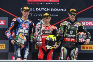 Jonathan Rea on the rostrum with Alvaro Bautista (centre) and Michael van der Mark after race two at Assen on Sunday.