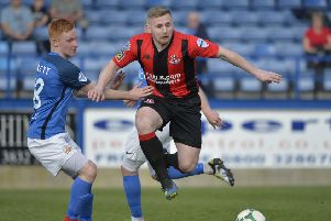 Crusaders David Cushley' on the attack against Glenavon