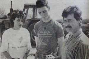 Tommy Gilmour (centre) who was competing in the tractor driving section of the YFC events with Robert Wright and Michelle Price. 1989