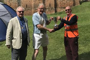 Mike Tansey is presented with a trophy for being the oldest finisher at the Two Castles Run. Pictures submitted