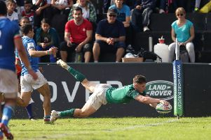 Ireland's Rob Russell scores a try' against Italy
