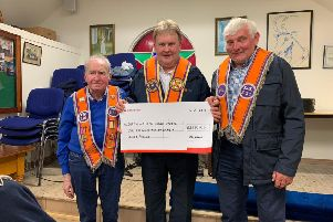 Moyasset True Blues LOL531 presents a cheque for �2,260  to Bro. Harold Henning (DGM) from the funds raised at their annual Saint Patrick's celebration held at Galgorm Community Centre. The money was raised for the Drew Nelson Legacy fund.