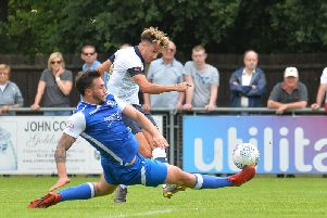 Harry Cornick lets fly against Bedford Town on Saturday