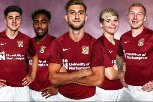 The new Cobblers home kit for season 2019/20 is modelled by (from left) Scott Pollock, new signing Reece Hall-Johnson, team captain Charlie Goode, Alex Bartlett from Northampton Town Ladies and club captain Nicky Adams