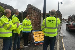 Members of Spilsby Town Council on the Speedwatch team - from left Coun Keith Larcombe, Coun Liz Day, Mayor Coun Terry Taylor and Coun Max Gibson with the speed gun.