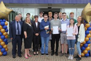 Antrim Grammar School pupils who gained three or more A*-A grades in their A Levels, pictued with Mr R McCune, MBE (Board of Governors), Mrs Jenny Lendrum (Principal), and representatives from the Education Authority