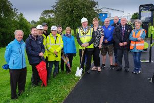 Mayor of Antrim and Newtownabbey, Alderman John Smyth pictured at the sod cutting ceremony of the new Council-led Environmental Improvement Scheme in Randalstown with local community, business and political representatives.