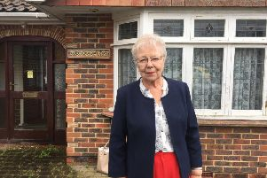 County councillor Anne Jones  outside Sharon Treacles home in Burgess Hill