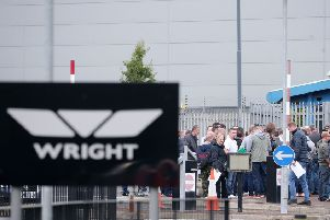 Former Wright Bus employees wait outside one of the former bus manufacturing factories where they were getting assistance with further employment. ''Picture by Jonathan Porter/PressEye