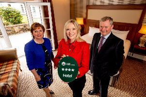 (L to R) are Catherine and Eugene McKeever, Managing Directors of McKeever Hotel Group with Caroline Adams from Tourism NI.