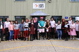 Staff at Aspen Pumps, Hailsham, wore it pink (and punk) on Friday to raise funds for Breast Cancer Now
