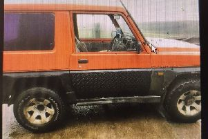 A red Daihatsu Fourtrak was stolen.