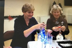Pictured during Broughshane WI's Christmas Party last month  are Becky Smyth and Sally McBurney (left to right) who were practising decorating festive bottles following a demonstration on the art by Sandra Adams
