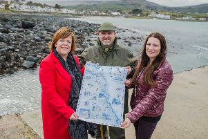From left,  Kelli Bagchus, manager of Carrickfergus Enterprise, John Robbin of Craicntour and Julie Campbell of The Ballygally Apartments. Pic by Carrie Davenport.