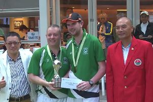Ian McClure and Aaron Tennant receive the Hong Kong Classic Bowls Pairs trophy.