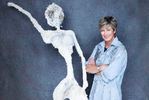 Lis Naylor and one of her sculptures