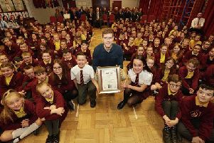Former Ireland and Ulster rugby legend, Andrew Trimble, presents Millburn Primary School with the Costa Outstanding Sports School Award 2018.