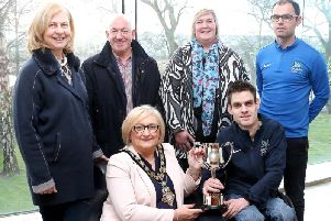 Paul McLister, the first person from Northern Ireland to win the Irish National BC4 Boccia Championship, pictured with the Mayor of Causeway Coast and Glens Borough Council Councillor Brenda Chivers, his parents Mary and Brian, Councillor Sandra Hunter and Boccia Performance Pathway Officer & Lead Coach Odhran Doherty, from Disability Sport NI.